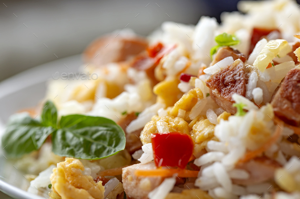 Salad made from rice, eggs, onion and herbs - Stock Photo - Images