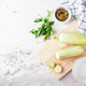 Fresh zucchini on a wooden board with a knife - PhotoDune Item for Sale