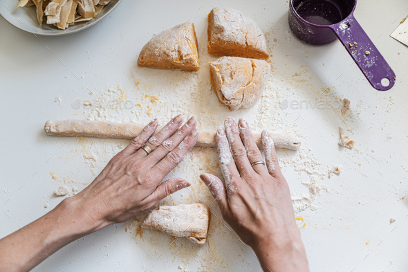 Female hands rolling pasta dough - Stock Photo - Images