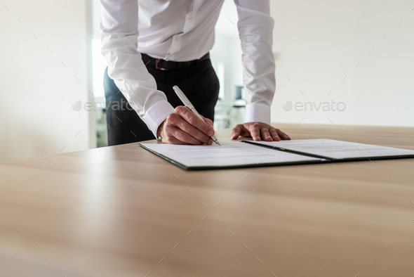 Entrepreneur signing document - Stock Photo - Images