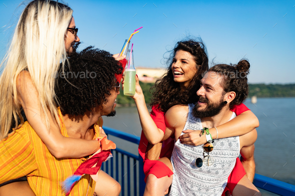 Happy young group of friends attending festivals at summer - Stock Photo - Images