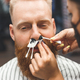 Removing hair from the nose with wax in barbershop, male beauty and care concept - PhotoDune Item for Sale