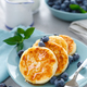 Cottage cheese pancakes, sweet curd fritters with berries, syrniki with honey and fresh blueberry - PhotoDune Item for Sale