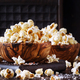 Salted popcorn in a wooden bowl, unhealthy food - PhotoDune Item for Sale