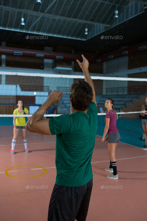 Rear view of player practicing volleyball - Stock Photo - Images