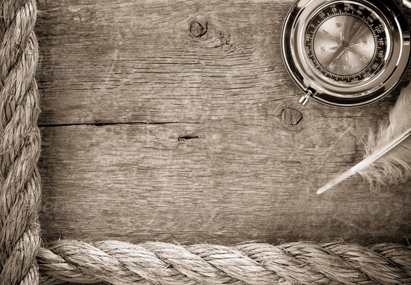 ship ropes and compass  on old wood - Stock Photo - Images