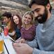 Friends using mobile phone in bar - PhotoDune Item for Sale
