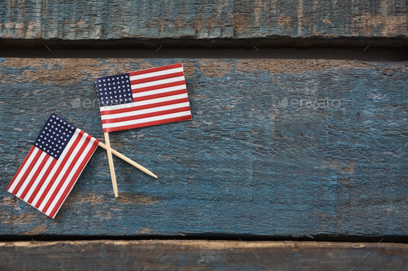 Two American flags on a wooden table - Stock Photo - Images