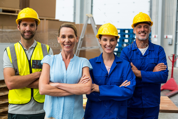 Portrait of warehouse manager and worker standing together with arms crossed - Stock Photo - Images
