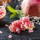 Sweet ping pomegranate on the black table - PhotoDune Item for Sale
