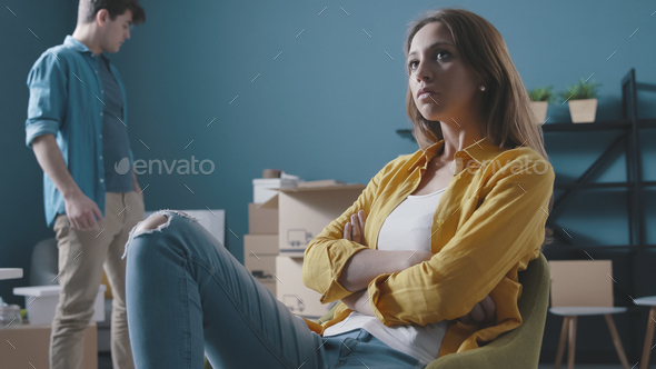 Angry couple fighting while moving in their new home - Stock Photo - Images