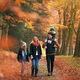 Family Walking Along Autumn Woodland Path With Father Carrying Son On Shoulders - PhotoDune Item for Sale