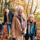 Grandparents With Grandchildren Enjoying Walk Along Autumn Woodland Path Together - PhotoDune Item for Sale