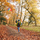Young Boy Having Fun Running Along Path Through Autumn Woodland Flying Kite - PhotoDune Item for Sale