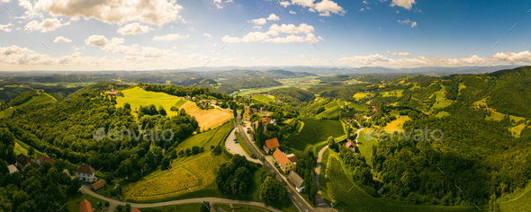 Aerial panorama of of green hills and vineyards with mountains in background. Austria vineyards - Stock Photo - Images