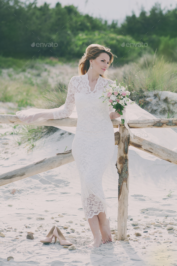Amazing Happy young woman in wedding dress - Stock Photo - Images