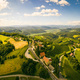 Aerial panorama of of green hills and vineyards with mountains in background. Austria vineyards - PhotoDune Item for Sale