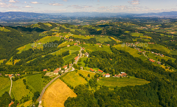 Aerial view of green hills and vineyards with mountains in background. Austria vineyards landscape - Stock Photo - Images