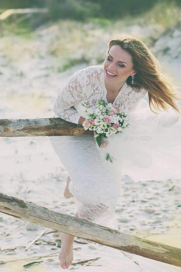 Happy young woman in wedding dress - Stock Photo - Images