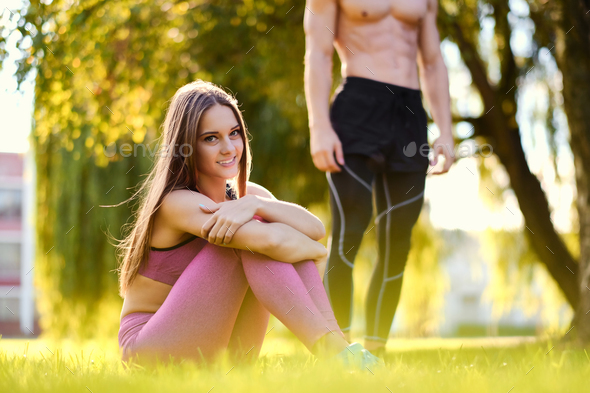Portrait of smiling sporty female in a pink sportswear. - Stock Photo - Images