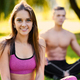 Sporty couple relaxing after fitness and yoga exercises. - PhotoDune Item for Sale