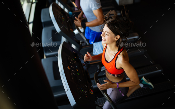 Fit group of people exercising on a treadmill in gym - Stock Photo - Images