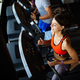 Fit group of people exercising on a treadmill in gym - PhotoDune Item for Sale