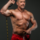 Muscular middle age man showing his muscules - PhotoDune Item for Sale