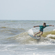 A young boy surfs waves on the Atlantic Ocean. - PhotoDune Item for Sale