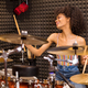Young black female drummer in a recording studio - PhotoDune Item for Sale