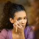 Attractive young black woman applying makeup - PhotoDune Item for Sale
