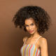 Cute young black woman with curly afro hairstyle - PhotoDune Item for Sale