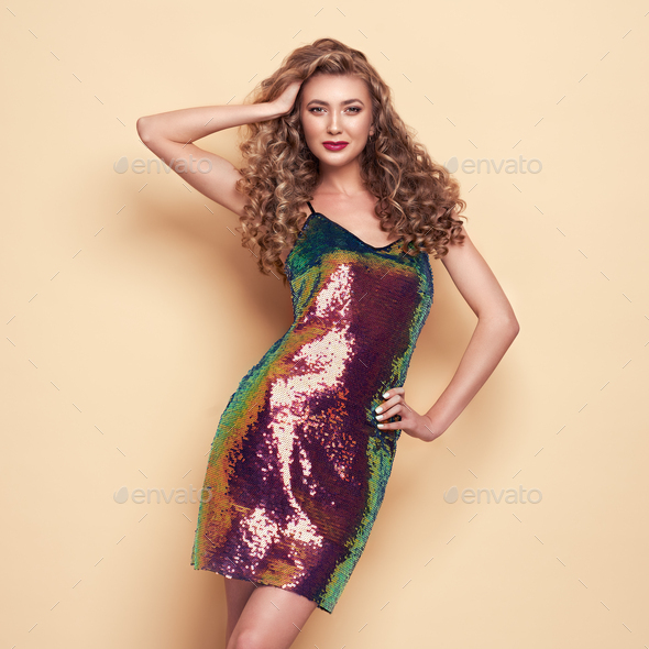 Blonde young woman in elegant holographic dress - Stock Photo - Images