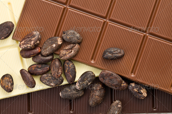 various chocolate bars with cocoa beans - Stock Photo - Images