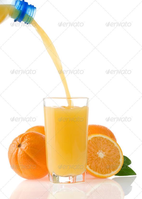 flowing juice and orange isolated on white - Stock Photo - Images