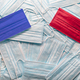 Republican Red and Democrat Blue Medical Face Masks Resting on a Pile of Other Face Masks - PhotoDune Item for Sale