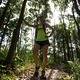 Young woman trail runner taking a rest while running in tropical forest - PhotoDune Item for Sale