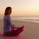 Woman performing yoga on the beach during sunset - PhotoDune Item for Sale