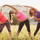 Three young woman exercising together in a park - PhotoDune Item for Sale