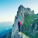Tourist on a rock in Switzerland. Active rest and tourism in summer time. - PhotoDune Item for Sale