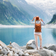 Tourist look on the lake view in Austria. Active rest and tourism in summer time. - PhotoDune Item for Sale