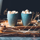 Hot chocolate with marshmallows and cinnamon in blue ceramic cups on a table - PhotoDune Item for Sale