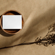 Top view of blank paper sheet card on wooden bowl with dry grass. - PhotoDune Item for Sale