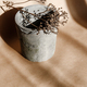 Abstract creative minimal composition with a clay pot and dry grass against kraft paper - PhotoDune Item for Sale