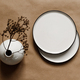 Modern minimalist ceramics plates with a linen cloth over kraft paper background - PhotoDune Item for Sale