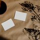 Top view of blank paper cards on a kraft paper. Mockup for business template. - PhotoDune Item for Sale