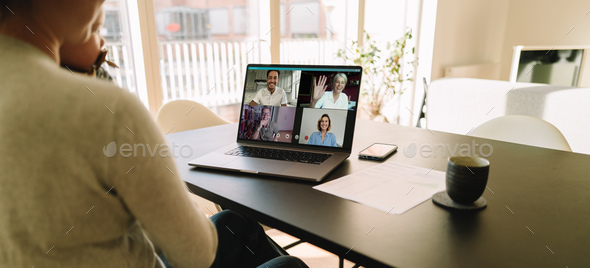 Business team meeting online over a video conference - Stock Photo - Images