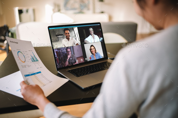 Businesswoman having online business meeting from home - Stock Photo - Images