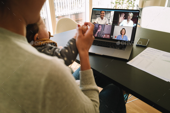 Woman at home video conferencing with colleagues - Stock Photo - Images