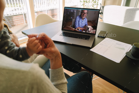 Woman having a video call with her father - Stock Photo - Images